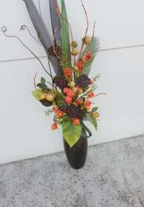 tall artificial flower arrangement