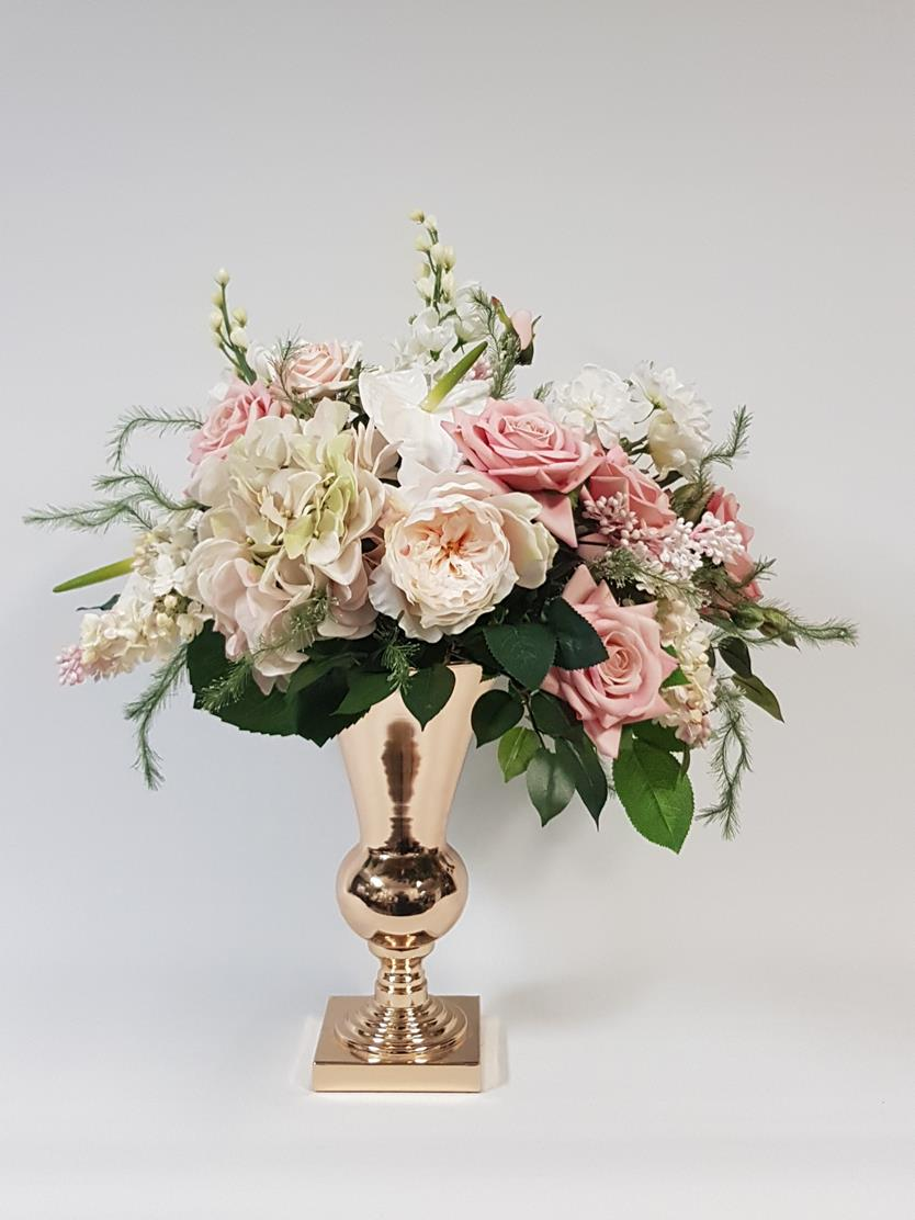 pink flowers and gold vase